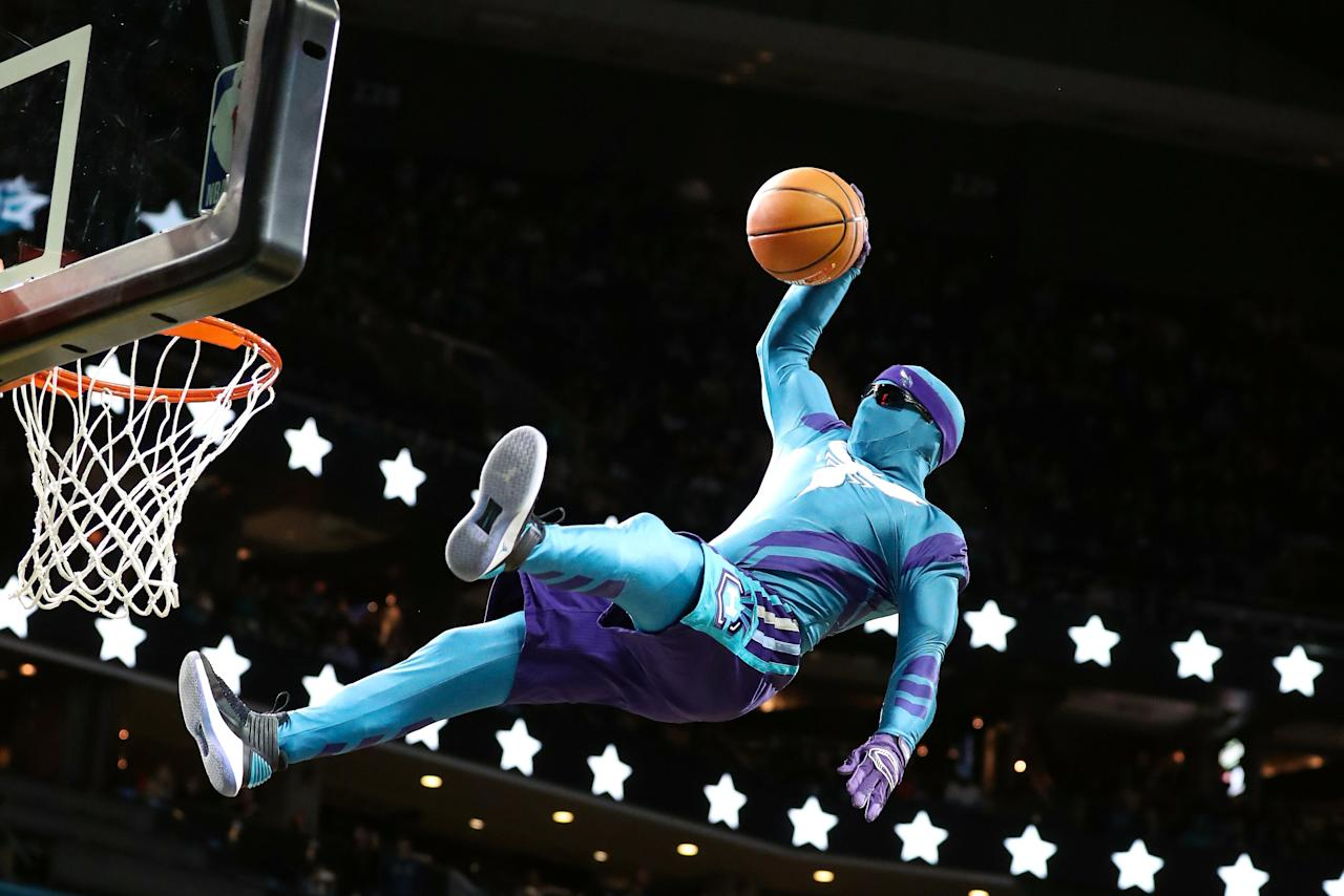 Nov 18, 2017; Charlotte, NC, USA; Charlotte Hornets mascot makes a dunk during a break in the second half against the LA Clippers at Spectrum Center. Mandatory Credit: Jim Dedmon-USA TODAY Sports     TPX IMAGES OF THE DAY