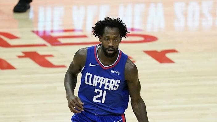 Los Angeles Clippers guard Patrick Beverley (21) controls the ball during the first quarter of an NBA basketball game against the Sacramento Kings Wednesday, Jan. 20, 2021, in Los Angeles. (AP Photo/Ashley Landis)