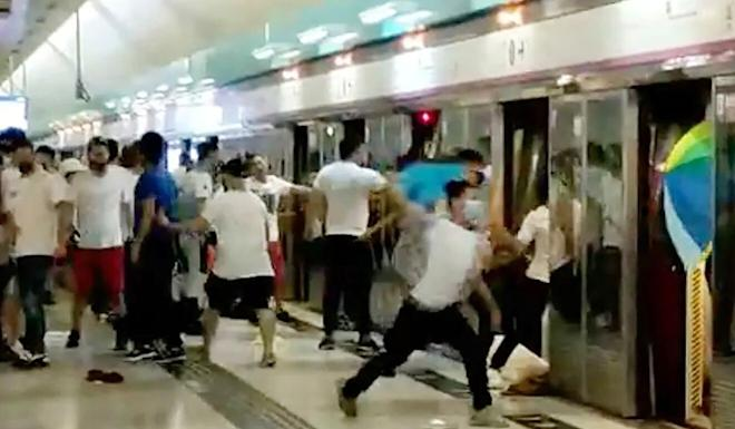 The mob attacks anti-government protesters and train passengers at Yuen Long rail station on July 21 last year. Photo: Handout