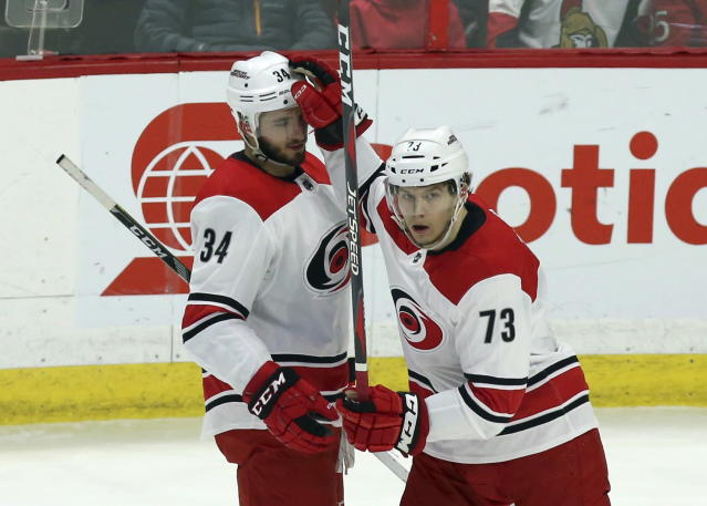 Carolina Hurricanes' Phillip Di Giuseppe (34) celebrates his goal against the Ottawa Senators with teammate Valetin Zykov (73) during first-period NHL hockey game action in Ottawa, Ontario, Saturday, March 24, 2018. (Fred Chartrand/The Canadian Press via AP)