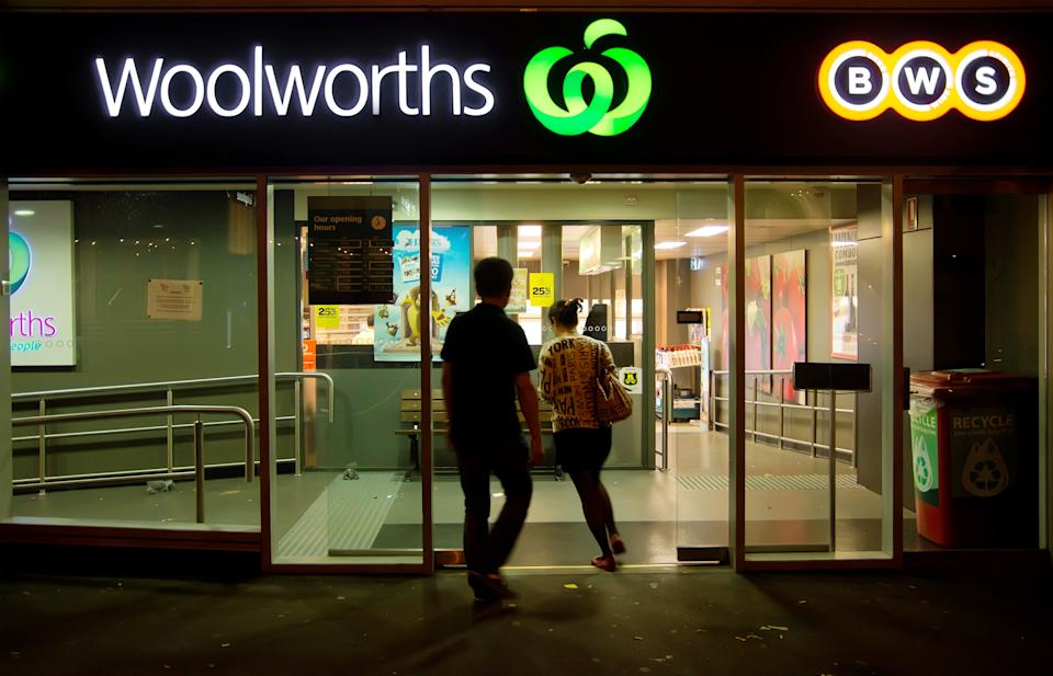 People walk in to a Woolworths store. Source: Getty Creative