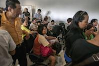 Family members of passengers on missing AirAsia Flight 8501 gather at Juanda international airport in Surabaya in East Java, waiting for news on the fate of their loved ones