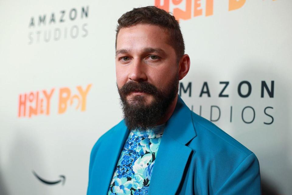 """<p>The <em>Peanut Butter Falcon</em> actor was seen out in Los Angeles in August with a face mask that read """"<a href=""""https://people.com/movies/shia-lebouf-shows-support-for-biden-in-presidential-campaign-race/"""" rel=""""nofollow noopener"""" target=""""_blank"""" data-ylk=""""slk:BIDEN"""" class=""""link rapid-noclick-resp"""">BIDEN</a>.""""</p>"""