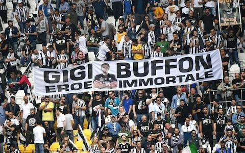 "Gianluigi Buffon's career has been defined by high emotion and drama, and his final Juventus appearance against Verona was a fittingly passionate goodbye. The legendary goalkeeper leaves Juventus this summer after 17 years of service, with reports linking the 40-year-old to West Ham and Liverpool. Buffon moved to Turin from Parma for £32.6 million in 2001, which stood as a world-record fee (sterling) for a goalkeeper until Manchester City signed Ederson in 2017. The former Italy No.1 lead Juventus out with his young children for their final game of the season with a fourth consecutive league and cup double already secured. Buffon walked behind the goal to personally greet a lucky few of his adoring fans, who paid homage to him with a colourful display of flags and banners. One last hurrah - Juventus fans watch Buffon between the sticks one last time Credit: AFP He was substituted in the 63rd minute of the game so that the Allianz Stadium could give him a standing ovation. Attention will now turn to Buffon's future, with rumours linking him to a number of clubs and he confirmed this week he has received some 'exciting' offers. ""Saturday I will play a match and that is the only thing that's certain,"" Buffon said. ""Until about two weeks ago, I was certain I would stop playing. Now offers have arrived that are exciting on and off the pitch and the most important for staying on the pitch was proposed to me by Agnelli. I'll let these three days pass and then I will make a definitive decision, completely calmly."" Buffon though, has ruled out playing for another Serie A club or dropping down the divisions in Italy. An emotional Buffon greets fans at the Allianz Stadium Credit: AFP ""I am not someone who thinks it is right to end my career in who knows what third or fourth level division,"" he said. ""I am a competitive animal and I wouldn't be able to live in that situation. I wouldn't feel at ease."" Buffon made headlines for the wrong reasons this season due to his extraordinary criticism of referee Michael Oliver after Juventus' cruel Champions League exit to Real Madrid. Juventus wiped out a three goal deficit with an impressive comeback in the Bernabéu but conceded a last-minute penalty which Cristiano Ronaldo scored to knock them out. The immortal hero Credit: AFP Buffon protested vociferously, shouting in the English referee's face and was sent-off on his final Champions League appearance. Buffon labelled Oliver an 'animal' in his post-match comments and said he must have a 'rubbish bin instead of a heart'. He subsequently apologised to Oliver but must now wait to see if Uefa decide to sanction him for the outburst. Former Arsenal goalkeeper Wojciech Szczesny is expected to takeover from Buffon as first-choice goalkeeper, while manager Max Allegri has indicated he is likely to stay."