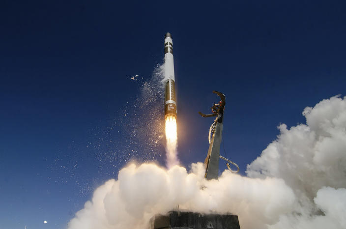 In this Oct. 17, 2019, photo supplied by Rocket Lab, an Electron rocket makes a successful launch from the Mahia Peninsula launch site on the North Island of New Zealand. New Zealand has become the latest country to sign a space agreement with U.S. space agency NASA, just as New Zealand's nascent space industry begins to take off. (Simon Moffatt/Rocket Lab via AP)