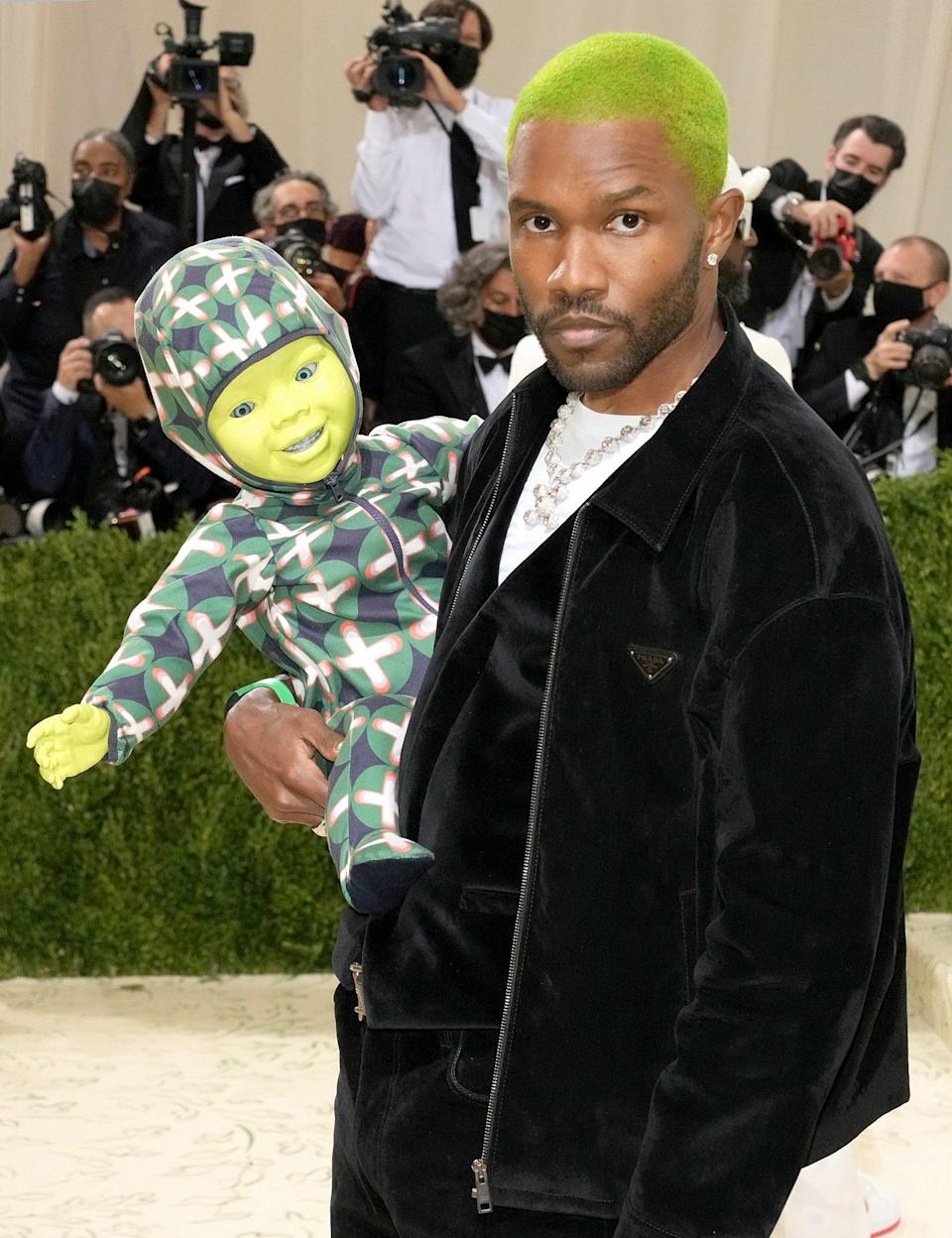 <p>Say what you want about Frank Ocean's robot baby at the 2021 Met Gala, but at least his lime green hair paired perfectly with his date. </p>