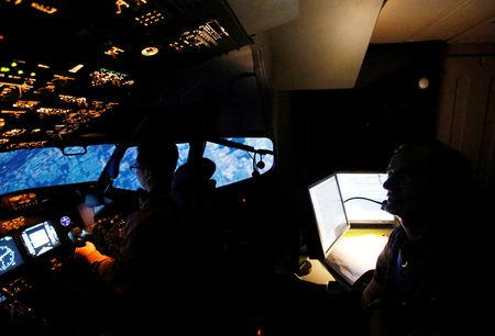An aviation student of Lion Air Group learns to fly away while a senior instructor supervises in Boeing 737-900ER simulator during a Jet Introduction session at Angkasa Training Center near Jakarta, Indonesia, November 2, 2018. REUTERS/Willy Kurniawan