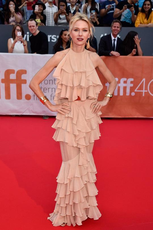 "<p>At the premiere of ""Demolition,"" her new film with Jake Gyllenhaal, Naomi Watts wore a nude Balmain dress. Ruffles cascaded from the halter neck to the hemline and the light peach, almost nude color surprisingly didn't drown out the pale-skinned Aussie actress. With her hair pulled back in a messy up-do and a dark red statement lip, Watts was frilly vision.</p>"
