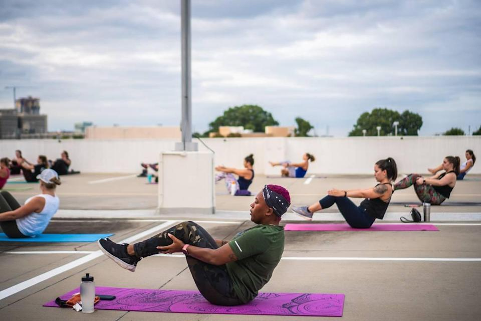 Sweatnet hosts outdoor group fitness workouts, such as this rooftop Pure Barre class.