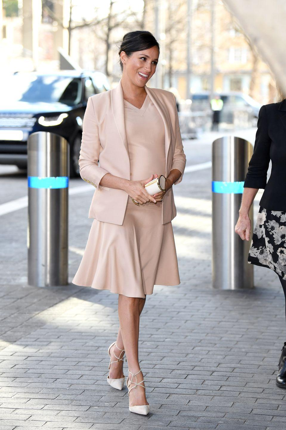 "<p>Meghan Markle chose a monochrome look for the first visit to her new patronage, the National Theatre. She wore a blush <a href=""https://www.net-a-porter.com/us/en/Shop/Designers/Brandon_Maxwell?gclsrc=aw.ds&cm_mmc=GoogleUS--c-_-NAP_EN_NY-_-NAP+-+AM+-+NY+-+Designer_Brandon+Maxwell+-+BT--Brandon+Maxwell+-+Alone+-+Exact-_-brandon%20maxwell_e_aud-314946096719:kwd-988907400_AM&gclid=CjwKCAiAs8XiBRAGEiwAFyQ-evzl75VtD0sQoX-tSmoroweEXZ7wTyyQJjFvx_XAROZ0P95HCWSQHBoCZ5EQAvD_BwE&pn=1&npp=60&image_view=product&dScroll=0"" rel=""nofollow noopener"" target=""_blank"" data-ylk=""slk:Brandon Maxwell"" class=""link rapid-noclick-resp"">Brandon Maxwell</a> dress, paired with a <a href=""https://chcarolinaherrera.com/ch00/en/women/bags/must-haves-b680170/item/black-metropolitan-insignia-small-clutch-bndaaca10bia9921-b828192"" rel=""nofollow noopener"" target=""_blank"" data-ylk=""slk:Carolina Herrera clutch"" class=""link rapid-noclick-resp"">Carolina Herrera clutch</a>, and <a href=""https://www.net-a-porter.com/us/en/product/1099862/Aquazzura/very-matilde-85-suede-pumps"" rel=""nofollow noopener"" target=""_blank"" data-ylk=""slk:Aquazzura pumps"" class=""link rapid-noclick-resp"">Aquazzura pumps</a>.</p><p><a class=""link rapid-noclick-resp"" href=""https://www.bergdorfgoodman.com/Aquazzura-Very-Matilde-Crisscross-Pumps/prod141470290/p.prod?eVar4=You+May+Also+Like"" rel=""nofollow noopener"" target=""_blank"" data-ylk=""slk:SHOP SIMILAR"">SHOP SIMILAR</a> <em>Very Matilde Crisscross Pumps, Aquazzura, $695</em></p>"