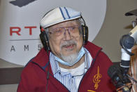 """In this photo provided by Radio Television Hong Kong (RTHK), 96-year-old DJ, Ray Cordeiro, also know as Uncle Ray, gestures after finished his last show """"All The Way with Ray"""" at the studio in RTHK, the broadcaster in Hong Kong on Feb. 15, 2021. After more than seven decades in radio, the 96-year-old Hong Kong DJ bid farewell to his listeners Saturday, May 15, 2021 with """"Time to Say Goodbye,"""" sung by Sarah Brightman and Andrea Bocelli. (Radio Television Hong Kong via AP)"""