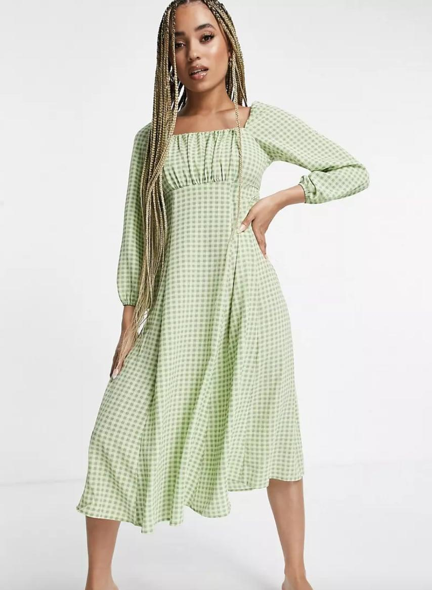 <p>The soft-green hue of this <span>ASOS Design Square Ruched Neck Midi Dress</span> ($36) makes it eye-catching and summery, but you can pair it with a trench coat for those warm fall days. The flowy silhouette and easygoing shape make it ideal for all-day wear.</p>