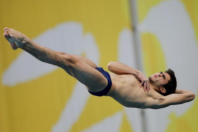 BEIJING, CHINA - MARCH 24: Ivan Garcia of Mexico competes in the Men's 10m Semi- Final during day two of the FINA/Midea Diving World Series 2012 Beijing Station at the National aquatics center-water cubeon on March 24, 2012 in Beijing, China. (Photo by Lintao Zhang/Getty Images)