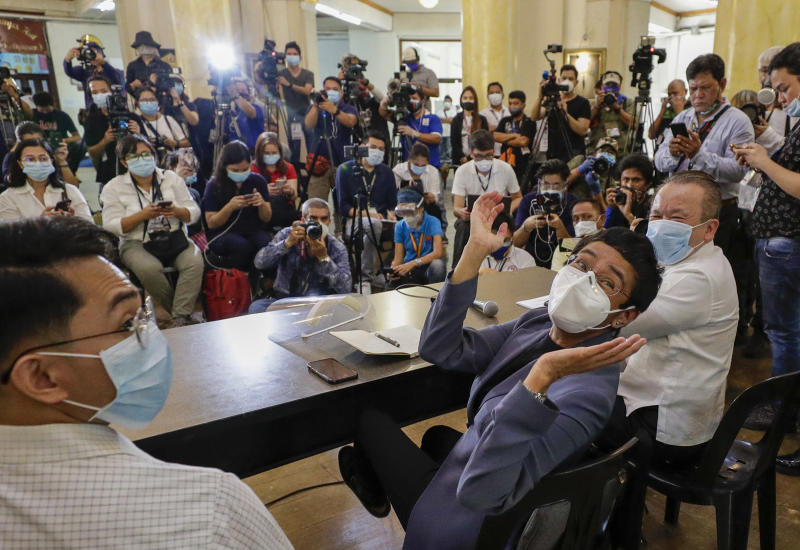 Rappler CEO and Executive Editor Maria Ressa, center, gestures beside former Rappler reporter Reynaldo Santos Jr., left, during a press conference in Manila, Philippines on Monday June 15, 2020. Ressa, an award-winning journalist critical of the Philippine president, her online news site Rappler Inc. and Santos were convicted of libel and sentenced to jail Monday in a decision called a major blow to press freedom in an Asian bastion of democracy. (AP Photo/Aaron Favila)