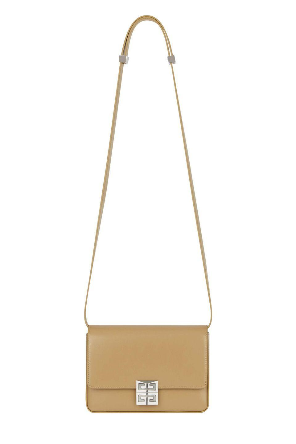 """<p><a class=""""link rapid-noclick-resp"""" href=""""https://www.givenchy.com/gb/en/medium-4g-bag-in-box-leather/BB50HCB15S-277.html#start=1"""" rel=""""nofollow noopener"""" target=""""_blank"""" data-ylk=""""slk:SHOP NOW"""">SHOP NOW</a></p><p>Keep it sleek, simple and undeniably elegant with Givenchy's 4G bag, which has a removable and adjustable shoulder strap, giving you multiple ways to wear it.</p><p>Leather bag, £1,450, <a href=""""https://www.givenchy.com/gb/en/medium-4g-bag-in-box-leather/BB50HCB15S-277.html#start=1"""" rel=""""nofollow noopener"""" target=""""_blank"""" data-ylk=""""slk:Givenchy"""" class=""""link rapid-noclick-resp"""">Givenchy</a></p>"""