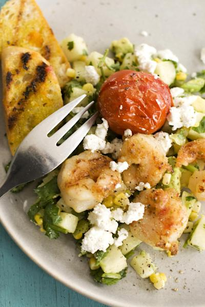 In this image taken on May 13, 2013, Caribbean grilled shrimp salad is shown served on a plate in Concord, N.H. (AP Photo/Matthew Mead)