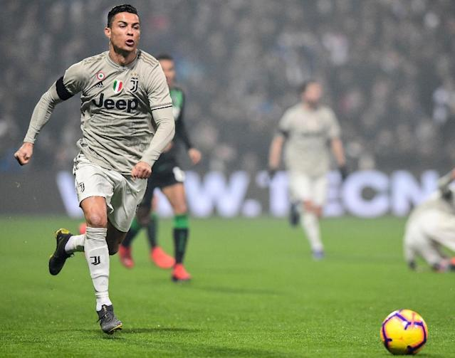 Cristiano Ronaldo is the Serie A's top scorer this season with 18 goals (AFP Photo/Miguel MEDINA)