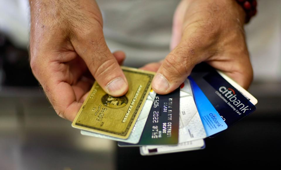 A man shows off some of his credit cards in Miami, Florida in 2009. (Photo: Joe Raedle/Getty Images)