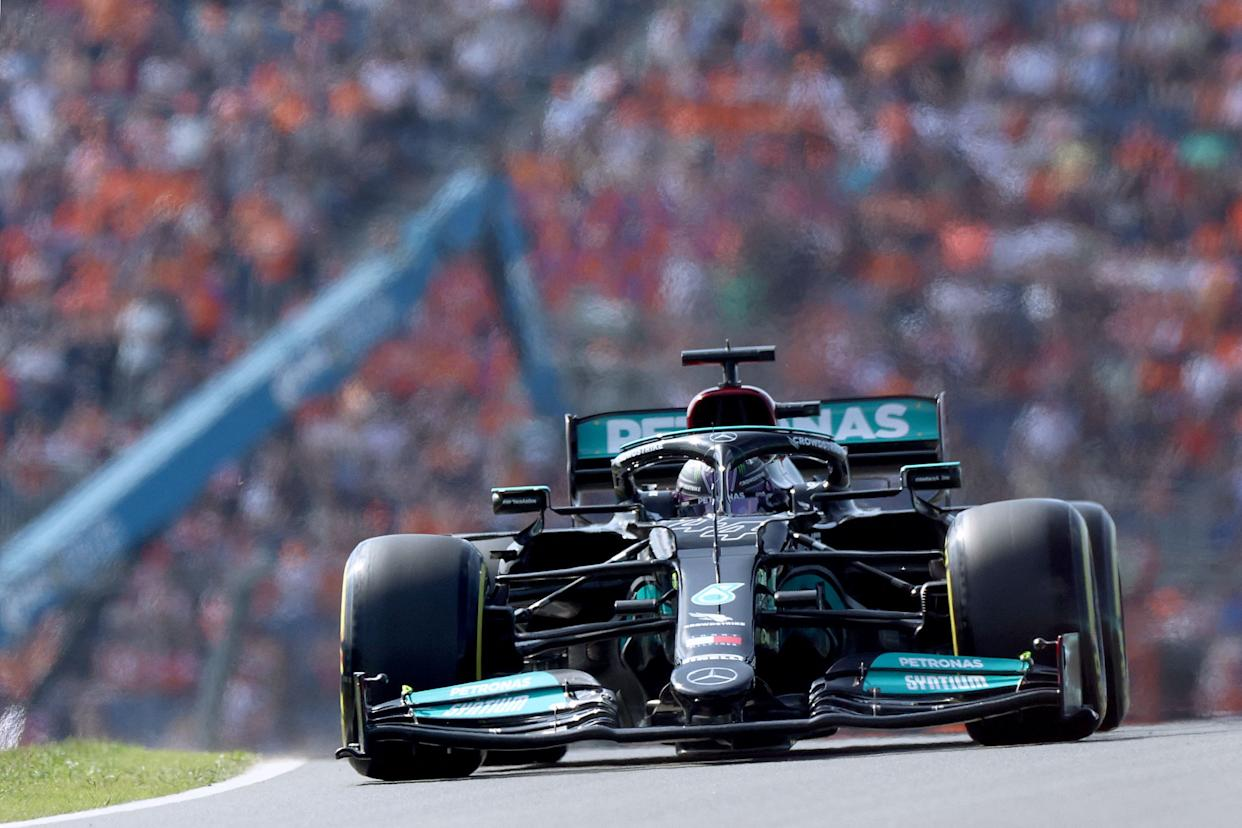 Mercedes' British driver Lewis Hamilton steers his car at the Zandvoort circuit during the second free practice session.