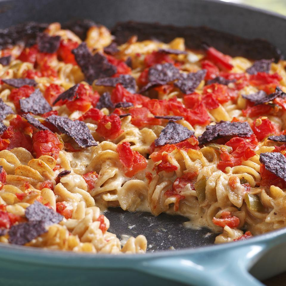 <p>Tuna mac & cheese takes a trip to the Southwest with spicy tomato and festive blue tortilla chips on top. Canned tomatoes with green chiles and ancho chile powder add a peppery kick, but if you like, you can keep it mellow by using a 14-ounce can of drained petite diced tomatoes and mild chili powder.</p>