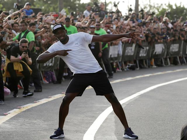 Usain Bolt poses after competing in a race against a moto-taxi as part of a sponsored event in Lima, Peru - April 2, 2019 REUTERS/Henry Romero
