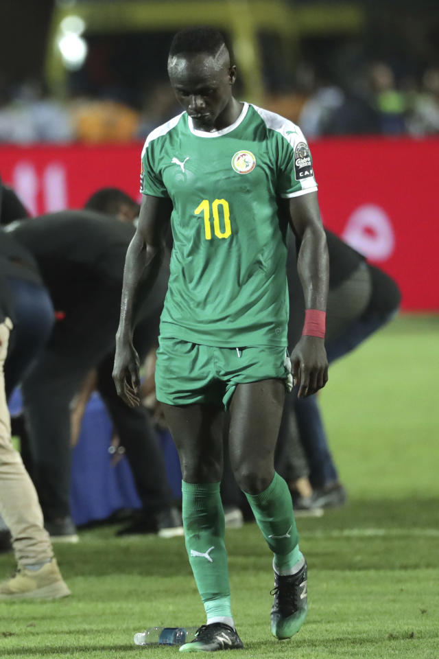 Senegal's Sadio Mane walks in dejection end the African Cup of Nations final soccer match between Algeria and Senegal in Cairo International stadium in Cairo, Egypt, Friday, July 19, 2019. Algeria won 1-0. (AP Photo/Hassan Ammar)