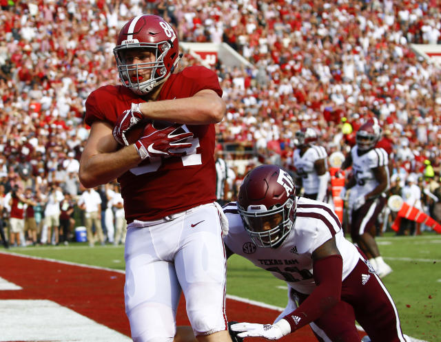 Alabama tight end Hale Hentges (84) catches a touchdown pass over Texas A&M defensive back Larry Pryor (11) during the first half of an NCAA college football game, Saturday, Sept. 22, 2018, in Tuscaloosa, Ala. (AP Photo/Butch Dill)