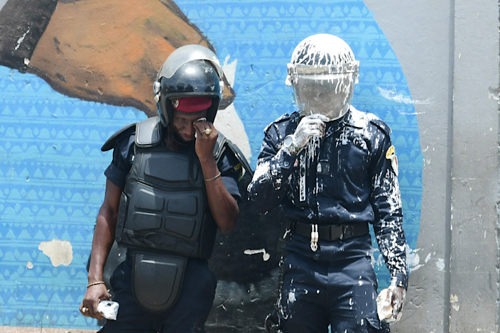 Anti-riot police officers, one covered in white paint, in Dakar, Senegal - Friday 25 June 2021