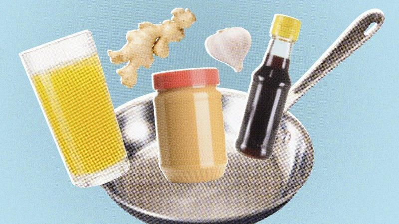 image of saute pan with ginger, garlic, soy sauce, peanut butter, and orange juice