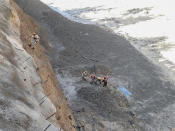 This photograph provided by Indo Tibetan Border Police (ITBP) shows ITBP personnel begin rescue work after a portion of Nanda Devi glacier broke off in Tapovan area of the northern state of Uttarakhand sending a massive flood of water, mud and debris into areas below, India, Sunday, Feb.7, 2021. (Indo Tibetan Border Police via AP)