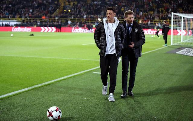 <span>Mesut Ozil pitch side before Germany's friendly with England</span> <span>Credit: PA </span>