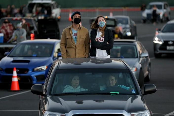 VENTURA, CA - JULY 18: Concert goers listen to Ozomatli at Concerts In Your Car - Fishbone, Ozomatli and Rey Fresco at the Ventura County Fairgrounds on Saturday, July 18, 2020 in Ventura, CA. This is one of the first legal returns to live music in SoCal since COVID-19, at a 700-capacity drive-in concert where patrons will watch in their vehicles and listen over FM radio. (Gary Coronado / Los Angeles Times)