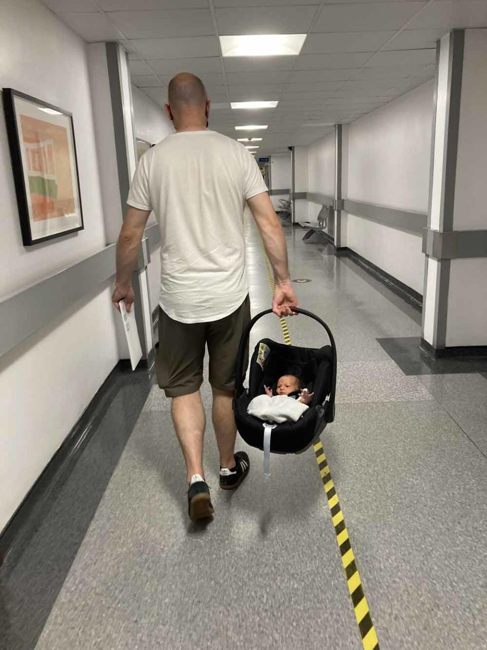 Rob carrying Willow Grace home from the hospital. PA REAL LIFE