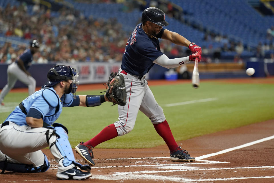 Boston Red Sox's Xander Bogaerts lines an RBI single off Tampa Bay Rays starting pitcher Rich Hill during the first inning of a baseball game Wednesday, June 23, 2021, in St. Petersburg, Fla. (AP Photo/Chris O'Meara)