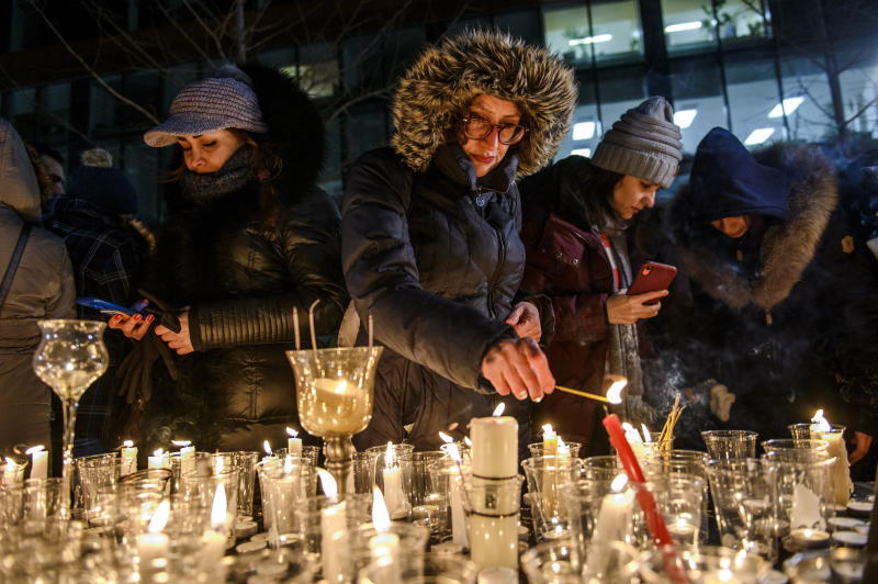 """Members of Montreal's Iranian community attend a vigil, Thursday, Jan. 9, 2019 in downtown Montreal. It is """"highly likely"""" that Iran shot down the civilian Ukrainian jetliner that crashed near Tehran late Tuesday, killing all 176 people on board, U.S., Canadian and British officials declared Thursday. They said the fiery missile strike could well have been a mistake amid rocket launches and high tension throughout the region. (Andrej Ivanov/The Canadian Press via AP)"""
