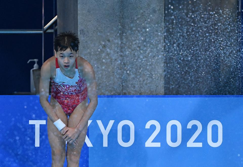 China's Quan Hongchan waits in the pool to see her final score before winning the women's 10m platform diving final event during the Tokyo 2020 Olympic Games at the Tokyo Aquatics Centre in Tokyo on August 5, 2021. (Photo by Attila KISBENEDEK / AFP) (Photo by ATTILA KISBENEDEK/AFP via Getty Images)
