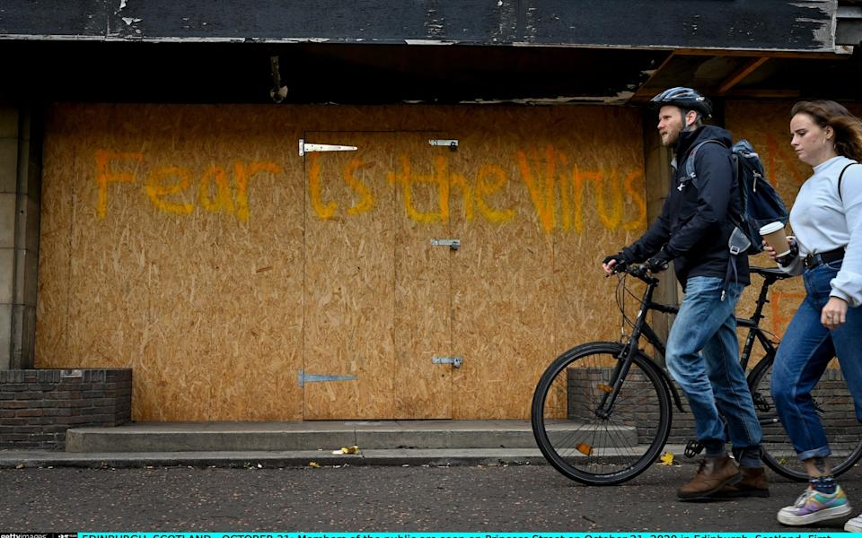 Members of the public are seen on Princess Street on October 21 - Jeff J Mitchell/Getty