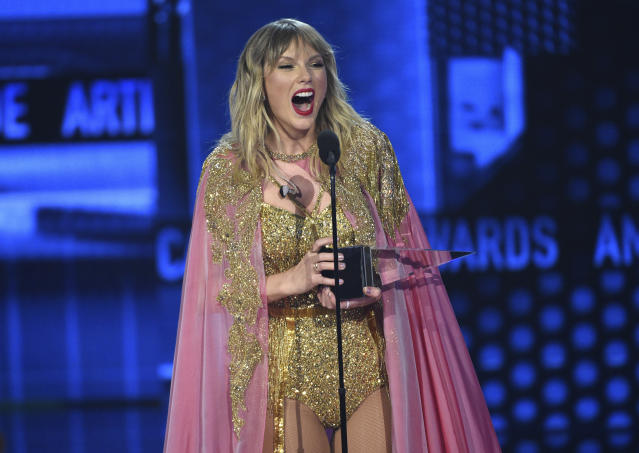 Taylor Swift accepts the award for artist of the decade at the American Music Awards on Sunday, Nov. 24, 2019, at the Microsoft Theater in Los Angeles. (Photo by Chris Pizzello/Invision/AP)