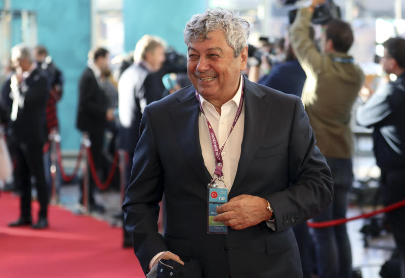 Turkey coach Mircea Lucescu arrives for the the UEFA Euro 2020 European soccer championship qualifying draw at the Convention Centre in Dublin, Ireland, Sunday, Dec. 2, 2018. (AP Photo/Peter Morrison)