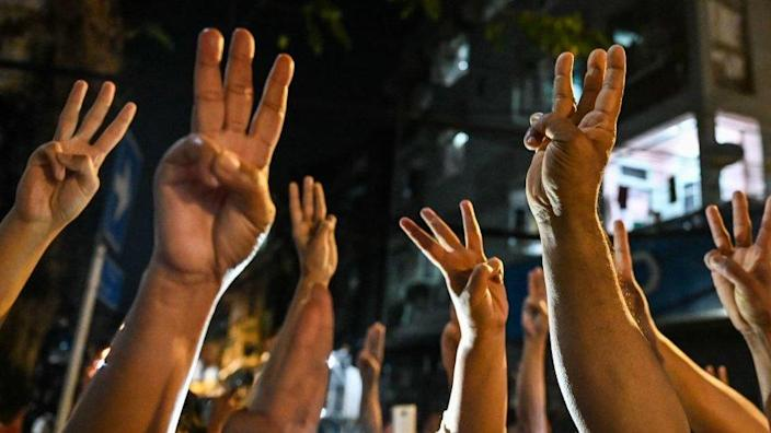 People give a three-finger salute
