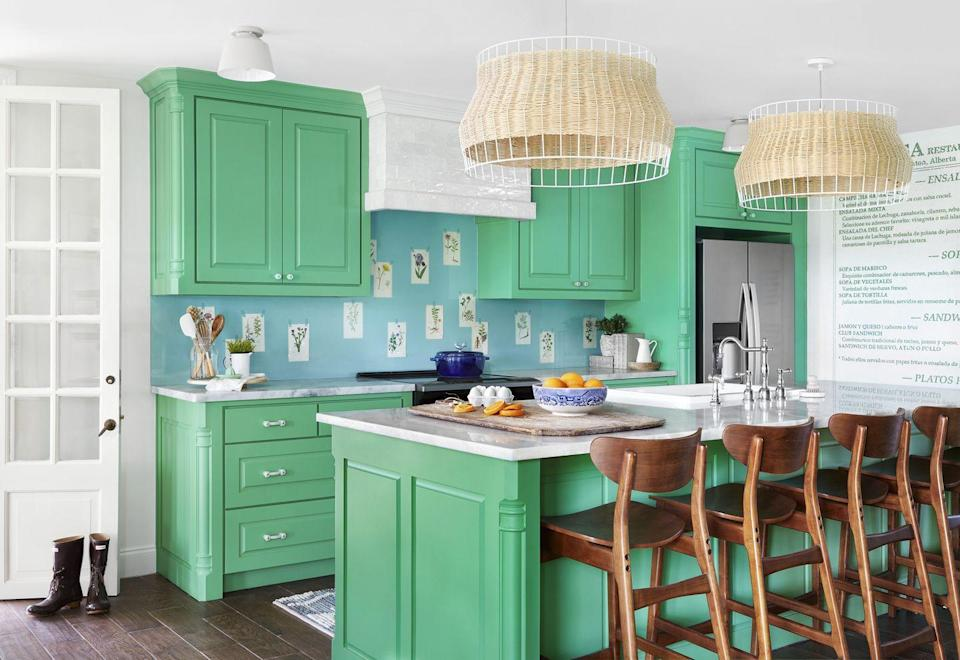 """<p>Colorful kitchens instantly bring joy! Feeling bold? Try an out-of-the-box color like <a href=""""https://www.sherwin-williams.com/homeowners/color/find-and-explore-colors/paint-colors-by-family/SW6739-eco-green"""" rel=""""nofollow noopener"""" target=""""_blank"""" data-ylk=""""slk:Eco Green by Sherwin-Williams"""" class=""""link rapid-noclick-resp"""">Eco Green by Sherwin-Williams</a> for a bright kitchen with serious wow-factor.</p>"""