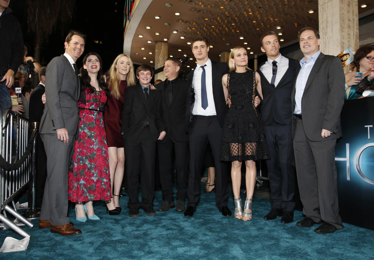 """Open Road Film's Jason Cassidy, Stephenie Meyer, Saoirse Ronan, Chandler Canterbury, Andrew Niccol, Max Irons, Diane Kruger, Jake Abel and Open Road Films' Tom Ortenberg arrive at the LA premiere of """"The Host"""" at the ArcLight Hollywood on Tuesday, March 19, 2013 in Los Angeles. (Photo by Todd Williamson/Invision/AP)"""