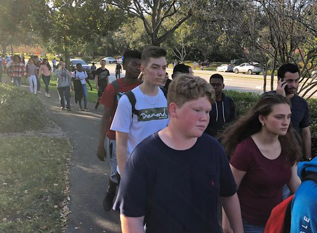 <p>Students leave Marjory Stoneman Douglas High School in Parkland, Florida, a city about 50 miles (80 kilometers) north of Miami on Feb. 14, 2018 following a school shooting. (Photo: Michele Eve Sandberg/AFP/Getty Images) </p>
