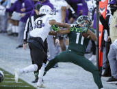Michigan State's Connor Heyward, right, is pushed out of bounds by Northwestern's Cameron Ruiz during the first half of an NCAA college football game, Saturday, Nov. 28, 2020, in East Lansing, Mich. (AP Photo/Al Goldis)