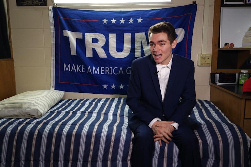 Conservative student Nick Fuentes, seen here during an interview in 2016, has dropped out of Boston University because of death threats owing to his attendance at the August 12 rally in Charlottesville, Virginia (AFP Photo/William EDWARDS)