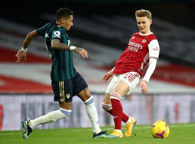 Martin Odegaard, right, made his full Arsenal debut