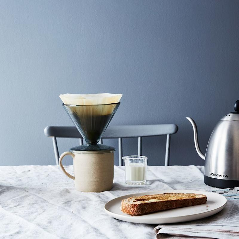 """Simply pop it onto your favorite mug, and you're ready for a fresh brew. <a href=""""https://food52.com/shop/products/3316-glass-pour-over"""" target=""""_blank"""">Shop it here</a>."""