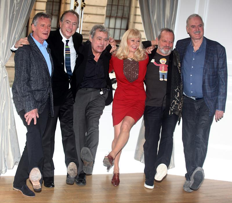 Michael Palin, Eric Idle, Terry Jones, Carol Cleveland,Terry Gilliam and John Cleese of the comedy troop Monty Python are seen at a photo call, on Thursday, Nov. 21, 2013 in London. They are reuniting for a project. (Photo by Jim Ross/Invision/AP)