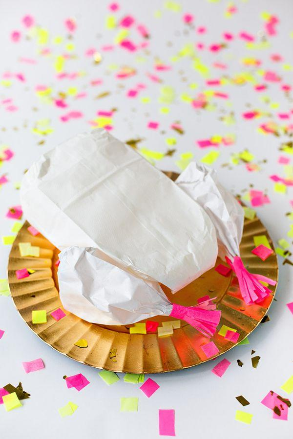 """<p>If this is your very first introduction to the idea of a """"Thanksgiving piñata,"""" well ... you're welcome! Stuff this paper bird with confetti and small candies, then let kids have at it once the meal is through. In the meantime, it can act as a gorgeous <a href=""""https://www.countryliving.com/entertaining/g2130/thanksgiving-centerpieces/"""">kids' table centerpiece</a>.</p><p><strong>Get the tutorial at <a href=""""https://studiodiy.com/2013/11/14/diy-confetti-stuffed-turkey/"""" target=""""_blank"""">Studio DIY</a>.</strong></p><p><strong><a class=""""body-btn-link"""" href=""""https://www.amazon.com/Value-White-Paper-Crafting-Bags/dp/B000PCWS4O?tag=syn-yahoo-20&ascsubtag=%5Bartid%7C10050.g.1201%5Bsrc%7Cyahoo-us"""" target=""""_blank"""">SHOP WHITE CRAFTING BAGS</a><br></strong></p>"""
