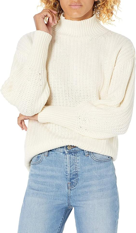 "<p>Be cozy in this <product href=""https://www.amazon.com/Drop-Womens-Mock-Neck-Sweater-Gardenia/dp/B08C8PGCSH/ref=sr_1_2?dchild=1&amp;qid=1599847652&amp;s=apparel&amp;sr=1-2"" target=""_blank"" class=""ga-track"" data-ga-category=""internal click"" data-ga-label=""https://www.amazon.com/Drop-Womens-Mock-Neck-Sweater-Gardenia/dp/B08C8PGCSH/ref=sr_1_2?dchild=1&amp;qid=1599847652&amp;s=apparel&amp;sr=1-2"" data-ga-action=""body text link"">The Drop Ines Chunky Rib Mock-Neck Sweater</product> ($50).</p>"